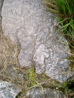 Stone with hand pointing forwards