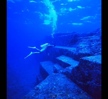 Diver at the submerged ruins of Yonaguni off coast of Japan dated 9,000 BC